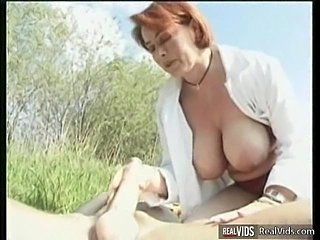 Plump mommy riding cock in the sun
