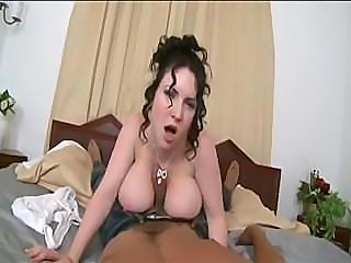 This big breasted woman really uses her tits to fuck his cock