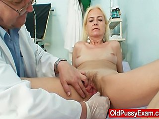 Blond grandma gets her hairy bushy aged vagina opened with a pussy spreader by a freaky woman doctor