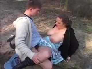 Young dude and busty  woman outdoo