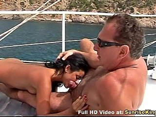 Girl gives a blowjob to an old guy on the boat