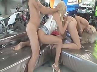 Famous bike racer destroying the assholes of two sexy blondies