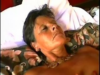 Short haired mature gives blowjob, fucks and receives facial