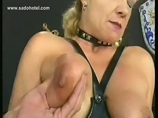 Blond milf slave with big tits is spanked and gets her tits  free
