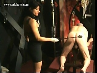 Masked slave got spanked on his ass by horny mistress with big fake tits in a...