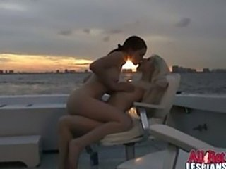 Sensual lesbian babes Britni and Vicci licking their slick pussies on a boat