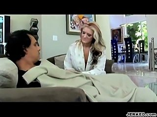 With her husband asleep on the couch.  Daryn Darby fucks a black guy.