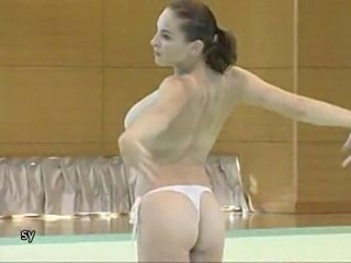 Corina doing topless gymnastics