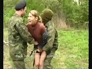 Young girl d by soldiers outdoors 1/2  free