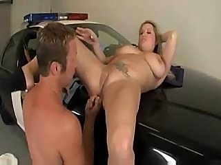 Police woman with nice jugs fucks her partner of top of the car