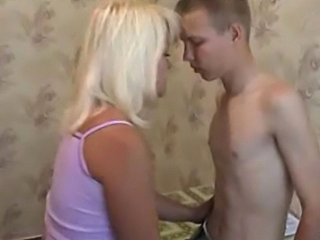 Really young guy fucked by milf