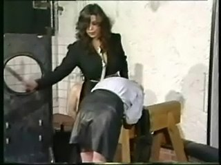 Slave in leather skirt is bend over by horny dominatrix with free