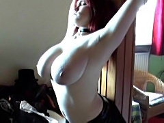 Redhead is a beauty and she models her body