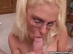 Topless blonde munching POV cock
