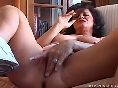 Gorgeous amateur cougar with nice big tits has a smokebreak and shows off her...