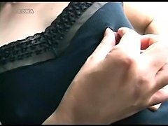 Japanese mature woman plays with her gigantic nipples: they stretch, pinch,...