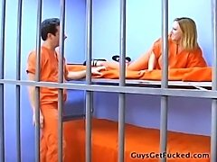 Female guard uses a strapon to fuck male prisoner in the cell, while another...