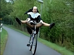 Nun on bike  free