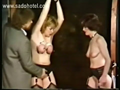 Milf slave with her tits tied together and large needles in  free