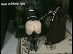 Horny nun slave is bend over a chair by a priest and spanked free