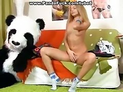 Blonde cutie is fucking a dude dressed up in a Panda Bear suit