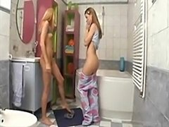 Two nubile teens getting it on with a toothbrush