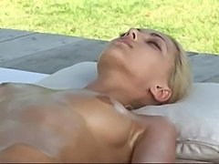 Beautiful slim blond naked, oiled and massaged