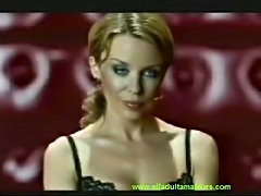 Kylie Minogue wet shirt and posing.. see that beauty