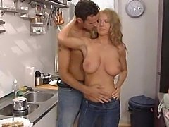 Busty blond enjoys cocks in the kitchen