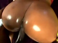 Two big booties covered in oil and butt fucked hard