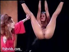 Hanged babe enjoy pussy spanking  free