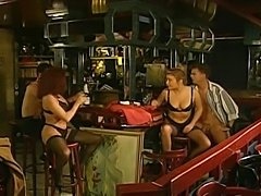 Two girls and two guys in the bar