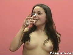 Piss: Vera drinks her own pee from a champagne glass