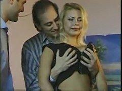 Three men bang a blonde in stockings