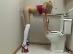 Blonde Teen Does It In Public Toilet!