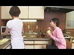 Japanese lesbians fool around in the kitchen