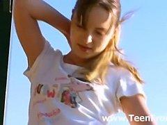 Super skinny teen teasing outdoors