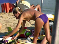 Voyeur sunbathing topless beach babes