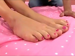 Hot blonde Kacey gets her feet and pussy fucked.  Gooey cum on her pretty,...