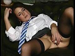 Schoolgirl puts a lollipop in her wet pussy