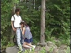 Japanese teen goes into the woods to suck on that hard cock