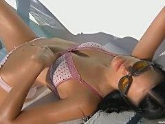Brunette beauty teasing at poolside