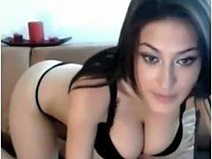 Busty brunette gets naked in front of the webcam