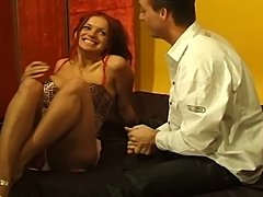 Hot threesome action featuring a horny redhead and twohorny studs.