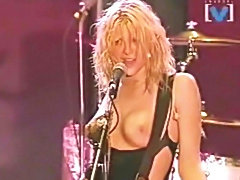 Celebrities classic Courtney Love topless during concert