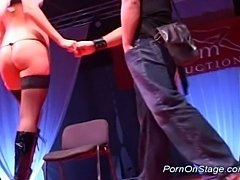 Twin strippers teasing on the stage and dildoing pussy