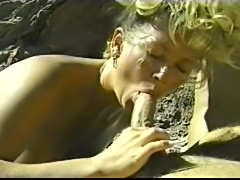 Johnni Black and another bitch in some hot threesome action outdoors.