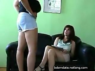 Two lesbian girls spanking and touching each other
