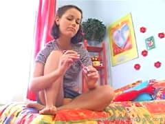 Cute teen paint her toes and gives lucky guy footjob
