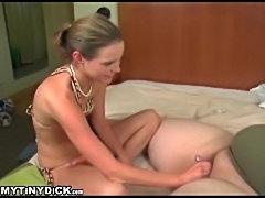 Sexy bikini chick chuckling as she strokes his tiny cock